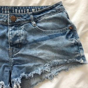 Mid Rise Frayed Denim Shorts